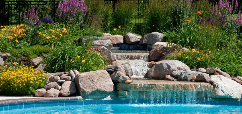 Beautifully landscaped backyard pool with a waterfall, Waterfall, Rock Waterfall